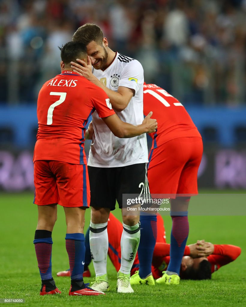 Shkodran Mustafi of Germany and Alexis Sanchez of Chile embrace after the FIFA Confederations Cup Russia 2017 Final between Chile and Germany at Saint Petersburg Stadium on July 2, 2017 in Saint Petersburg, Russia.