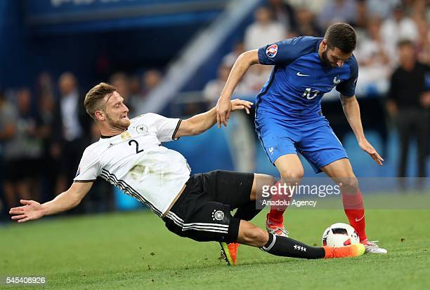 Shkodran Mustafi of Germany and AndrePierre Gignac of France vie for the ball during the UEFA Euro 2016 semi final match between Germany and France...