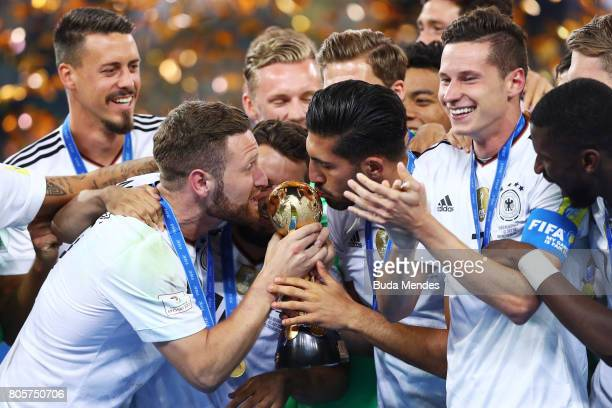 Shkodran Mustafi of Germany and Julian Draxler of Germany kiss the trophy after the FIFA Confederations Cup Russia 2017 Final between Chile and...