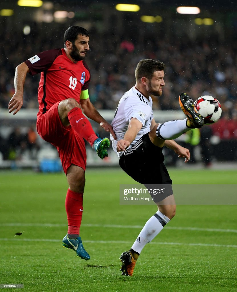 Shkodran Mustafi (R) of Germany and Rahid Amirguliyev of Azerbaijan battle for the ball during the FIFA 2018 World Cup Qualifier between Germany and Azerbaijan at Fritz-Walter-Stadion on October 8, 2017 in Kaiserslautern, Rhineland-Palatinate.