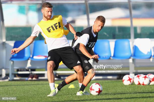 Shkodran Mustafi of Germany battles for the ball with his team mate Joshua Kimmich during a team Germany training session at Park Arena training...