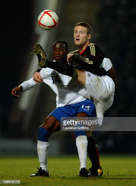 Shkodran Mustafi of Germany battles with Jordan Slew of England during the International Friendly match between England U19 and Germany U19 at the...