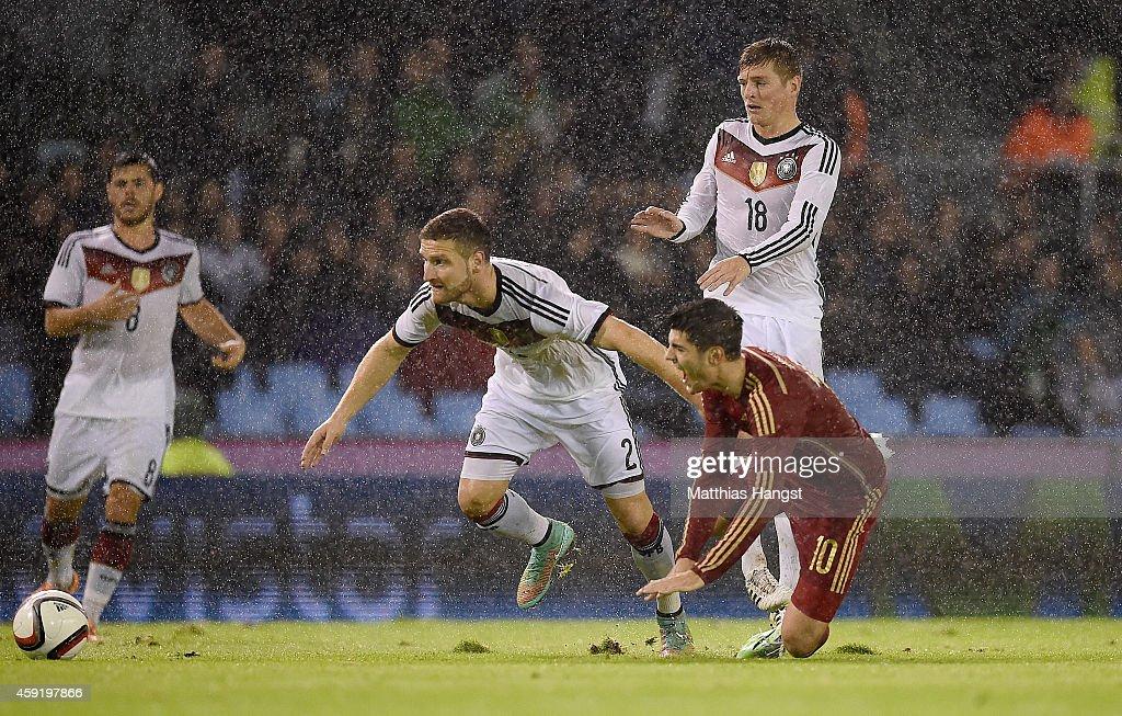 Shkodran Mustafi (L) of Germany blocks Alvaro Morata (R) of Spain during the International Friendly match between Spain and Germany at Estadio Balaidos on November 18, 2014 in Vigo, Spain.