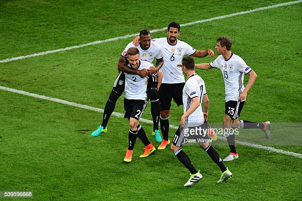 Shkodran Mustafi of Germany celebrates after he heads his side into the lead during GroupC preliminary round between Germany and Ukraine at Stade...