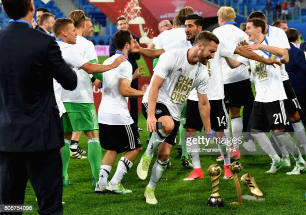 Shkodran Mustafi of Germany celebrates with the FIFA Confederations Cup trophy after the FIFA Confederations Cup Russia 2017 Final between Chile and...