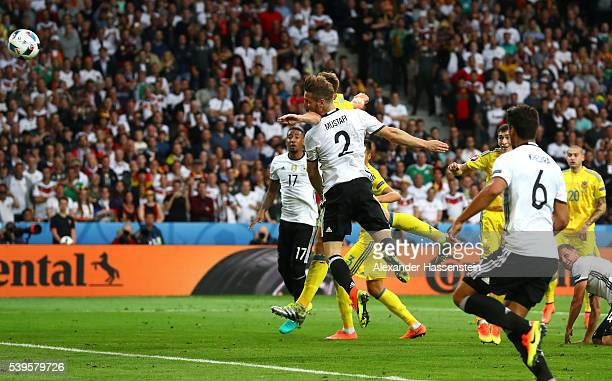 Shkodran Mustafi of Germany heads the ball to score his team's first goal during the UEFA EURO 2016 Group C match between Germany and Ukraine at...