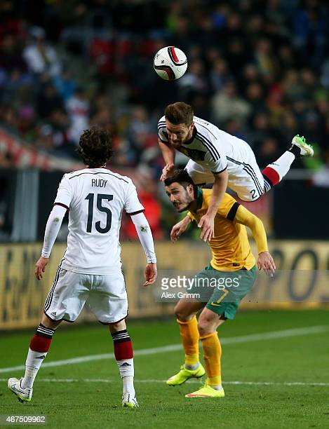 Shkodran Mustafi of Germany is upended as he competes for the ball with Matthew Leckie of Australia during the International Friendly match between...