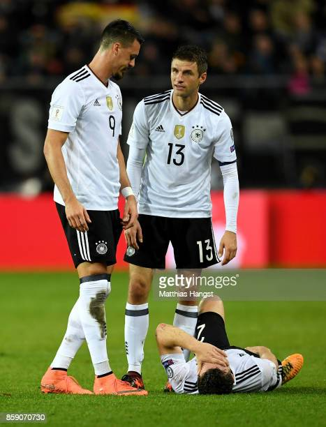 Shkodran Mustafi of Germany lies injury on the pitch during the FIFA 2018 World Cup Qualifier between Germany and Azerbaijan at FritzWalterStadion on...
