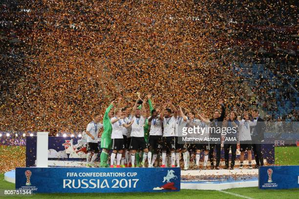 Shkodran Mustafi of Germany lifts the trophy with his teammates at the end of the FIFA Confederations Cup Russia 2017 Final match between Chile and...