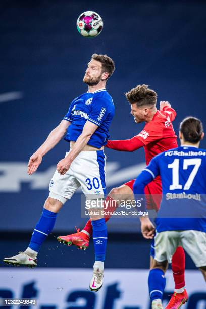 Shkodran Mustafi of Schalke heads the ball during the Bundesliga match between FC Schalke 04 and FC Augsburg at Veltins-Arena on April 11, 2021 in...