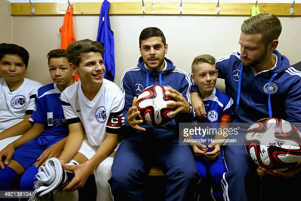 Shkodran Mustafi of the German national team and his team mate Kevin Volland talk to the players in the dressing room prior to the football match...