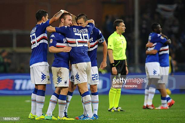 Shkodran Mustafi of UC Sampdoria celebrates victory with team mate at the end of the Serie A match between UC Sampdoria and Atalanta BC at Stadio...