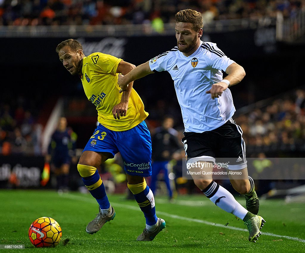 Shkodran Mustafi (5) of Valencia battle for the ball Dani Castellano (23) of Las Palmas during the La Liga match between Valencia CF and UD Las Palmas at Estadi de Mestalla on November 21, 2015 in Valencia, Spain.