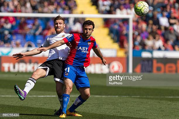 Shkodran Mustafi of Valencia CF and 21 Giuseppe Rossi of Levante UD during la liga match between Levante UD and Valencia CF at Ciutat de Valencia...