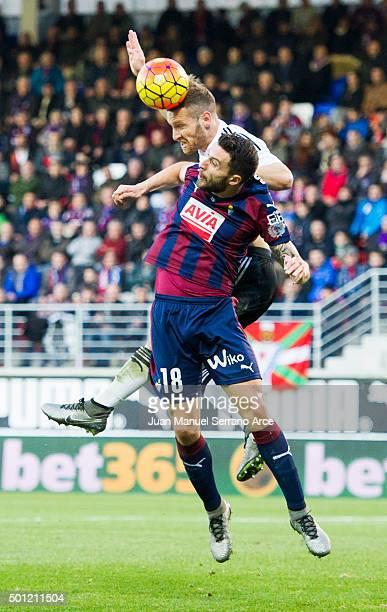 Shkodran Mustafi of Valencia CF duels for the ball with Borja Gonzalez of SD Eibar during the La Liga match between SD Eibar and Valencia CF at...
