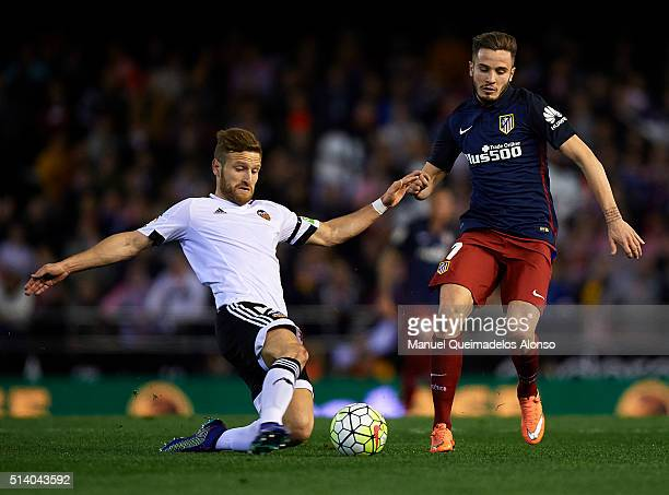 Shkodran Mustafi of Valencia competes for the ball with Saul Niguez of Atletico de Madrid during the La Liga match between Valencia CF and Atletico...