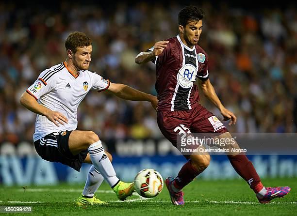Shkodran Mustafi of Valencia competes for the ball with Vico of Cordoba during the La Liga match between Valencia CF and Cordoba CF at Estadio...