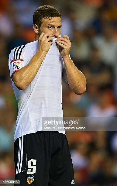 Shkodran Mustafi of Valencia reacts during the La Liga match between Valencia CF and Cordoba CF at Estadio Mestalla on September 25 2014 in Valencia...