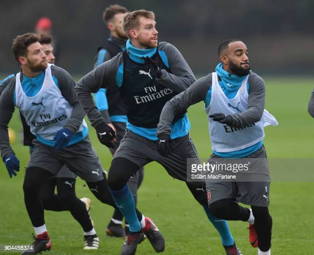 Shkodran Mustafi Per Mertesacker and Alex Lacazette of Arsenal during a training session at London Colney on January 13 2018 in St Albans England