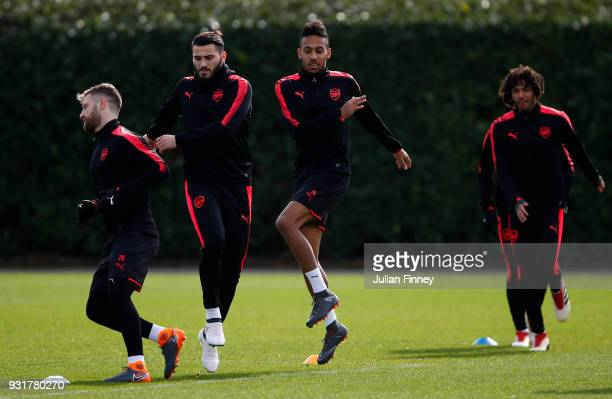Shkodran Mustafi Sead Kolasinac PierreEmerick Aubameyang and Mohamed Elneny of Arsenal during an Arsenal Training Session ahead of there Europa...