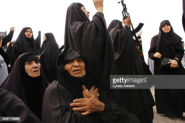 Shnaa Zahir center flagellates herself among other Iraqi Shiite women during a gathering for the holiday of Ashorra during Muharram March 1 2004 in...
