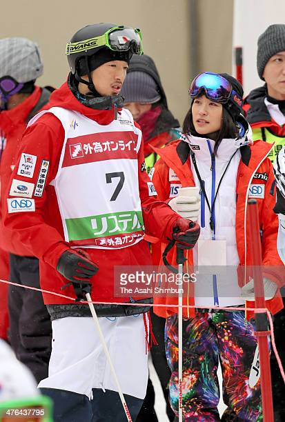 Sho Endo and Aiko Uemura of Japan talk during 2014 FIS Free Style Ski World Cup Inawashiro at Listel Inawashiro on March 2 2014 in Inawashiro...