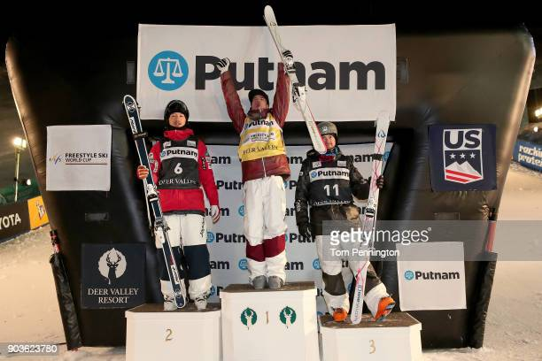 Sho Endo of Japan in second place Mikael Kingsbury of Canada in first place and Bradley Wilson of the United States in third place celebrate on the...