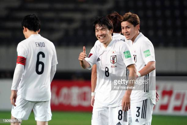Sho Inagaki of Japan celebrates scoring his side's fourteenth goal with his team mates during the FIFA World Cup Asian Qualifier second round between...