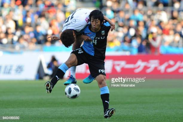 Sho Inagaki of Sanfrecce Hiroshima and Kengo Nakamura of Kawasaki Frontale compete for the ball during the JLeague J1 match between Kawasaki Frontale...
