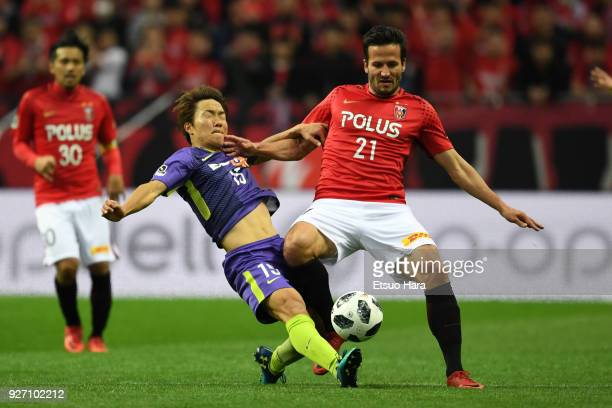 Sho Inagaki of Sanfrecce Hiroshima and Zlatan Ljubijankic of Urawa Red Diamonds compete for the ball during the JLeague J1 match between Urawa Red...