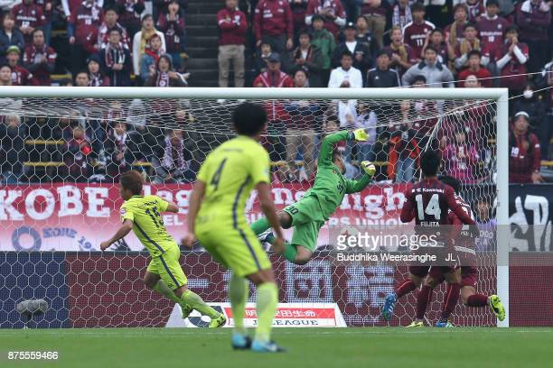 Sho Inagaki of Sanfrecce Hiroshima scores the opening goal past Kenta Tokushige of Vissel Kobe during the JLeague J1 match between Vissel Kobe and...