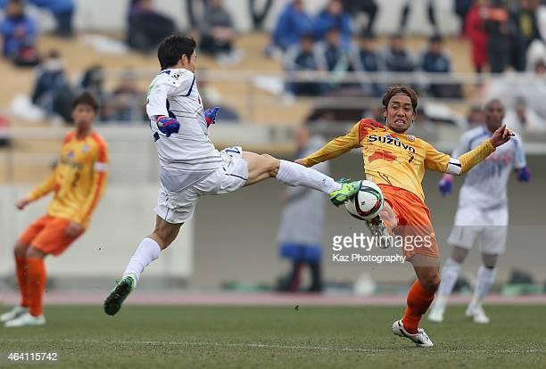 Sho Inagaki of Ventforet Kofu and Takuya Honda of Shimizu S-Pulse compete for the ball during the pre-season match between Shimizu S-Pulse and...