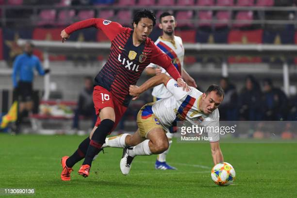 Sho Ito of Kashima Antlers and Benjamin Kantarovski of Newcastle Jets compete for the ball during the AFC Champions League play off between Kashima...