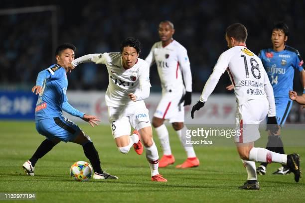 Sho Ito of Kashima Antlers and Ryota Oshima of Kawasaki Frontale compete for the ball during the JLeague J1 match between Kawasaki Frontale and...