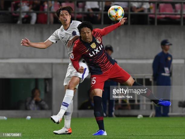 Sho Ito of Kashima Antlers and Yuki Nogami of Sanfrecce Hiroshima compete for the ball during the AFC Champions League round of 16 first leg match...