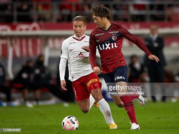 Sho Ito of Kashima Antlers competes for the ball with Ryosuke Yamanaka of Urawa Red Diamonds during the J.League Meiji Yasuda J1 match between...