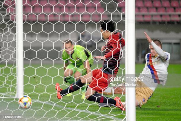 Sho Ito of Kashima Antlers scores the opening goal during the AFC Champions League play off between Kashima Antlers and Newcastle Jets at Kashima...
