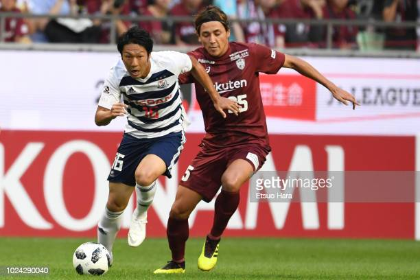 Sho Ito of Yokohama FMarinos and Leo Osaki of Vissel Kobe compete for the ball during the JLeague J1 match between Vissel Kobe and Yokohama FMarinos...