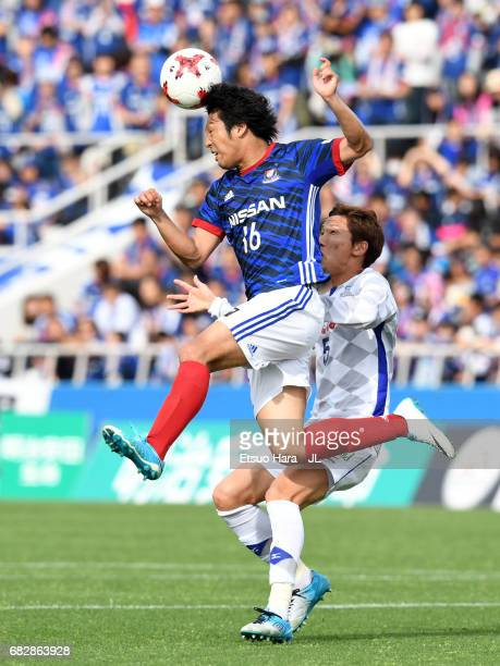 Sho Ito of Yokohama FMarinos and Ryo Shinzato of Ventforet Kofu compete for the bal during the JLeague J1 match between Yokohama FMarinos and...
