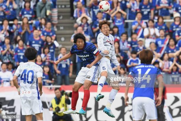 Sho Ito of Yokohama FMarinos and Ryo Shinzato of Ventforet Kofu compete for the ball during the JLeague J1 match between Yokohama FMarinos and...