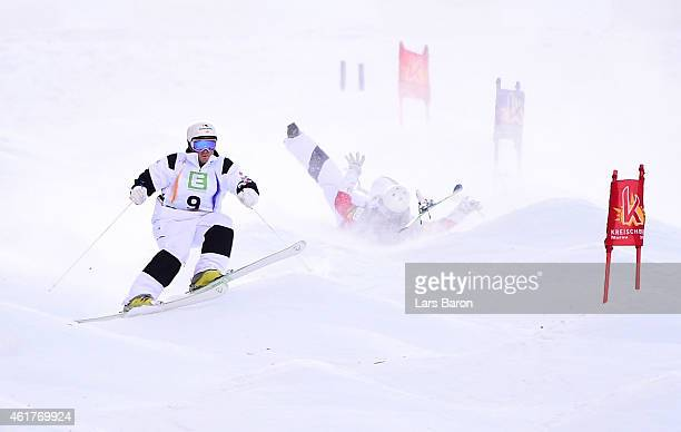 Sho Kashima of USA crashes next to MarcAntoine Gagnon of Canada during the Men's Dual Moguls bronze medal finale of the FIS Freestyle Ski and...