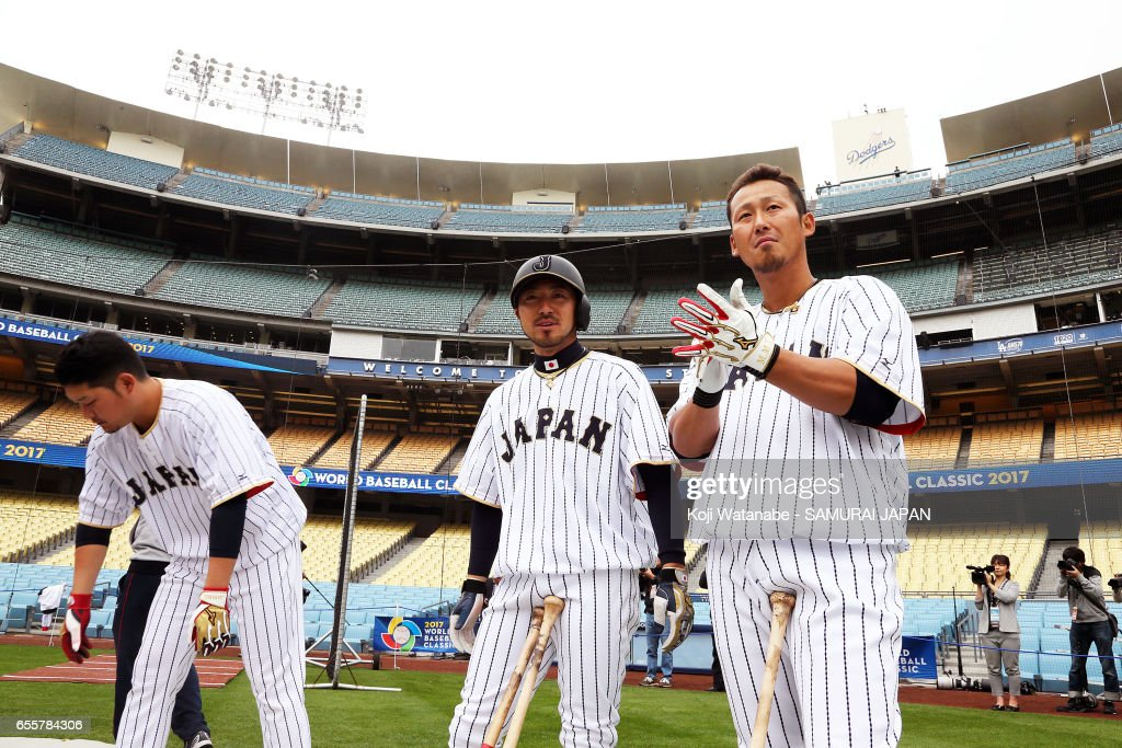Sho Nakata #13 (R) and Ryosuke Kikuchi #4 (C) of Japan look on during a training session ahead of the World Baseball Classic Championship Round at Dodger Stadium on March 20, 2017 in Los Angeles, California.