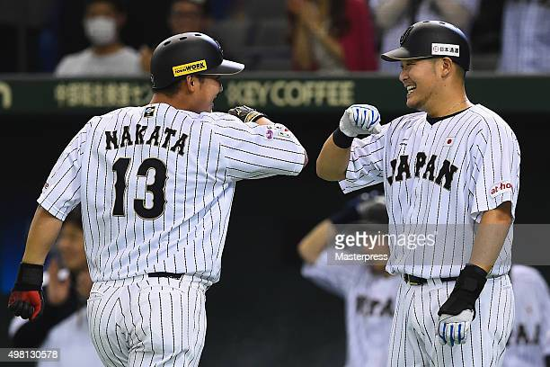 Sho Nakata of Japan celebrate with Yoshitomo Tsutsugo of Japan after hitting a tworun homerun in the bottom half of the second inning during the WBSC...