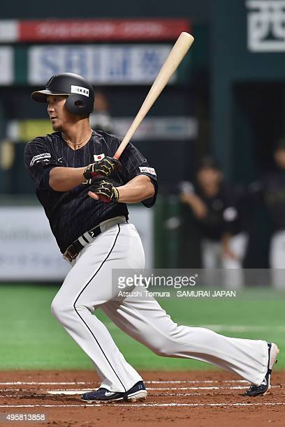 Sho Nakata of Japan hits a single in the top half of the second inning during the sendoff friendly match for WBSC Premier 12 between Japan and Puerto...