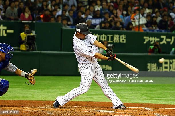Sho Nakata of Samurai Japan hits a two-run homer in the third inning during the game three of Samurai Japan and MLB All Stars at Tokyo Dome on...