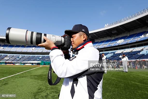 Sho Nakata of Samurai Japan takes photographs of his teammates during the Japan national baseball team practice session at the QVC on November 7 2016...