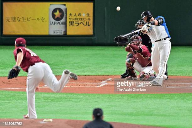 Sho Nakata of the Hokkaido Nippon Ham Fighters hits a two-run homer against Masahiro Tanaka of Tohoku Rakuten Golden Eagles in the 1st inniing at the...