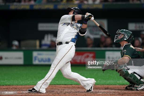 Sho Nakata of the Hokkaido NipponHam Fighters at bat during the game between Hokkaido NipponHam Fighters and Oakland Athletics at Tokyo Dome on March...