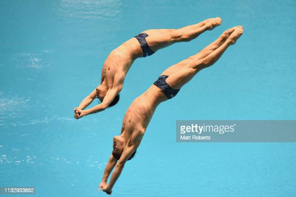 Sho Sakai and Ken Terauchi of Japan compete during the Men's 3m Synchro Springboard Final on day one of the FINA Diving World Cup Sagamihara at...