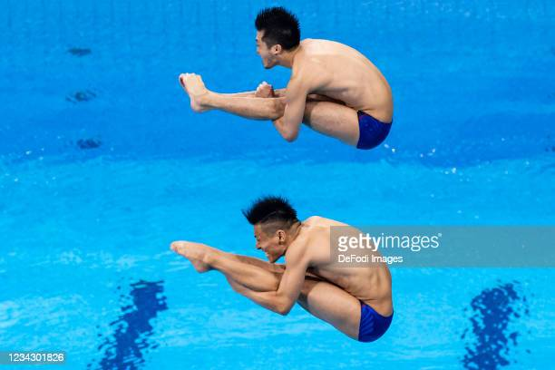 Sho Sakai of Japan and Ken Terauchi of Japan compete during the Men's Synchronised 3m Springboard Final on day five of the Tokyo 2020 Olympic Games...